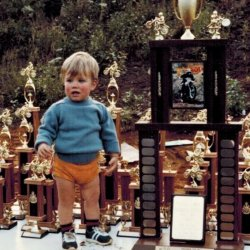 Tyler with Dan's trophies